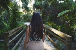 woman walking on fort myers preserve trail